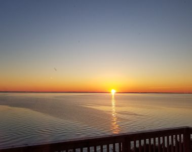 Sunrise over the Chesapeake Bay viewed from the deck, dining room & upstairs bed