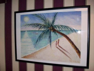 As you enter the house you are greeted by a  lovely African beach.