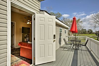 Relax and dine on the spacious porch with a 4-person outdoor table.