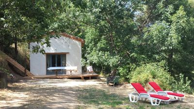Photo for Eco cottage in Monts et Merveilles, swimming pool, riverside, 3 ha of nature.