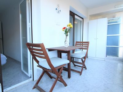 Photo for Close to the beach in quiet area with wifi and air con