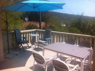 Photo for Two bedroom apartment with terrace and sea view Rukavac, Vis (A-15486-a)
