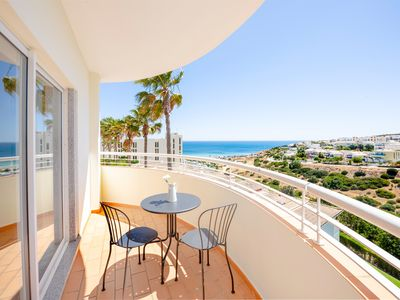 Photo for Bask in the Sun in style - spectacular views, beach 5-min away (for real!)