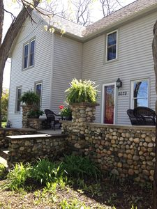 Large stone front porch with table & chairs. Great place to enjoy morning coffee
