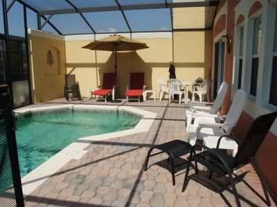 Photo for 4BR, 3BA T/home w/ Screened-In Heated Pool (4722)