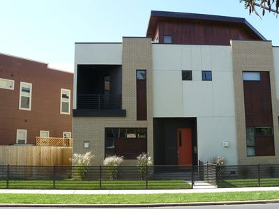 Photo for DOWNTOWN LIVING! Modern three story home with rooftop views!