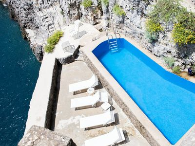 Photo for A stone tower on the sea with private dock and pool saltwater