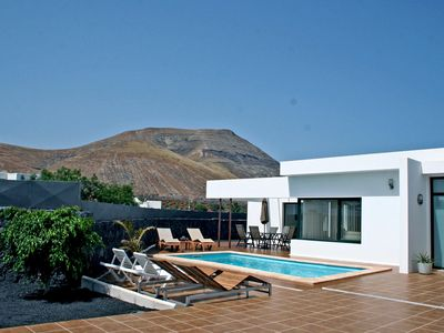 Photo for Modern villa with private heated pool , 15 minutes from beaches and Timanfaya