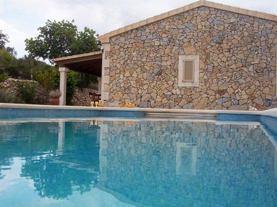 Photo for Typical Majorcan house with terrace and pool with beautiful sunset.