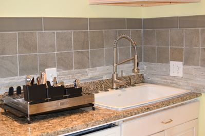 Lots of room to clean up with this oversize sink and high-end faucet