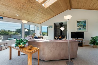 Modern living room with sectional couch and wood stove