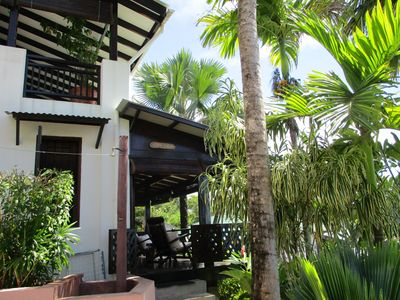 Photo for Studio in tropical garden, unique view, very close to the beach