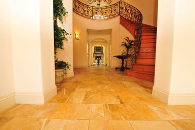 The Grand Foyer, featuring the magnificent spiral staircase and custom railing.