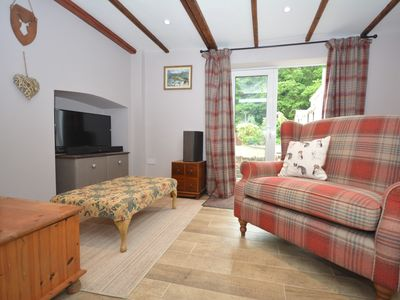 Snug with TV/DVD, character beams and doors to pretty garden