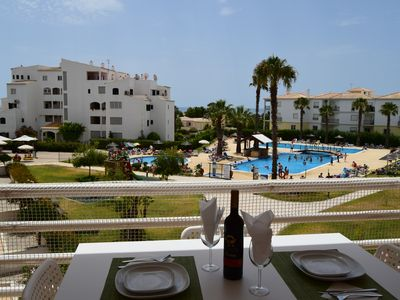 Photo for Lovely holiday apartment with great pools and sea view