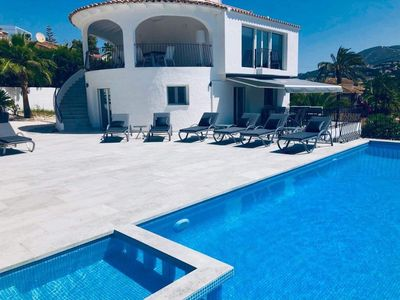 Photo for 6 Bedroom Seaview Villa minutes from Moraira Beach. Heated swimming pool