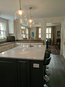 Open floor plan with renovated kitchen. Large island seats 4, bar seats 3