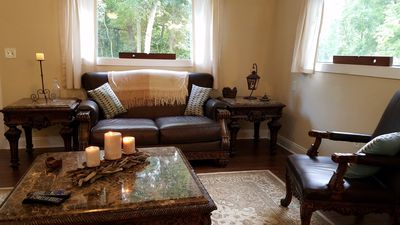 Large Living room has a gas fireplace, real leather furniture.