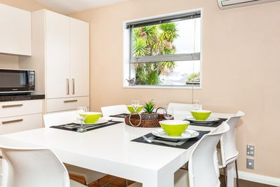 The dining room comes with a wonderful view and a full set of dining ware.