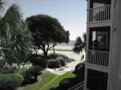 View of beach from screened porch.