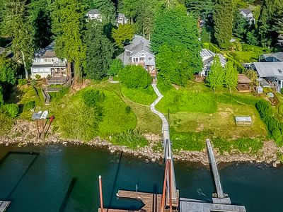 Photo for Stunning riverfront home w/ spacious deck, grill, two kitchens, & private dock!