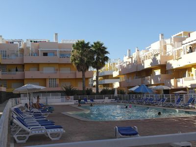 Photo for 2 Bedrooms apartment on a private complex with swimmingpool and near the beach