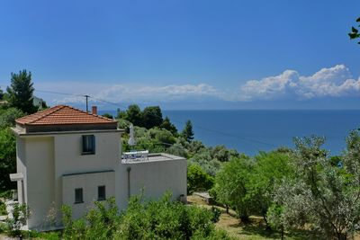 house and gardens overlooking the Aegean Sea