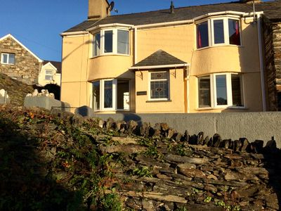Photo for 19thC Welsh cottage in quiet location Between the mountains and the sea