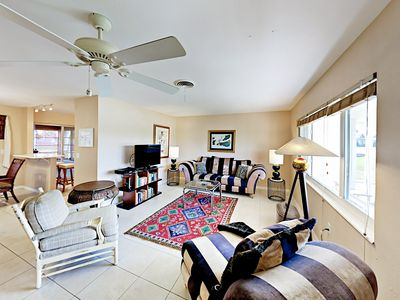 """Living Room - Get comfy on the sofa and armchairs around the 43"""" flat-screen TV in the living room."""