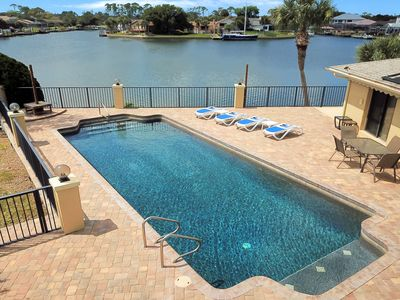 Photo for Dog-friendly, waterfront paradise w/ private pool, dock, & poolside bar
