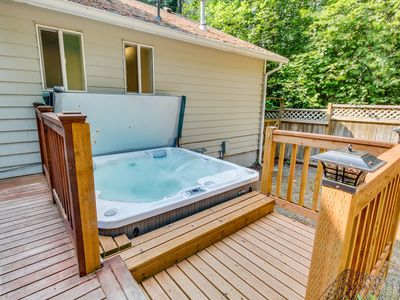 Photo for Dog-friendly retreat w/private hot tub, firepit and fenced backyard