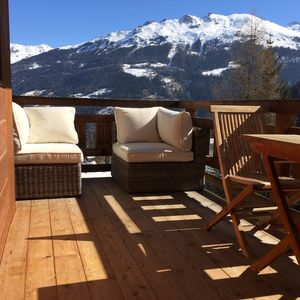 Photo for Ski Apartment Next to The Piste With Views Over Village And Mountains
