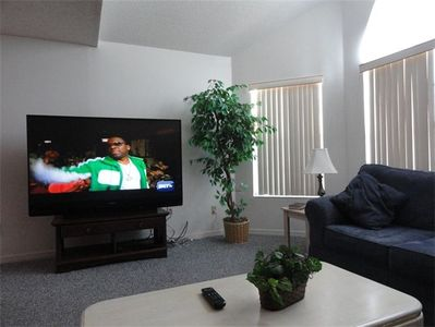 65' TV with Blu-ray in Living Room