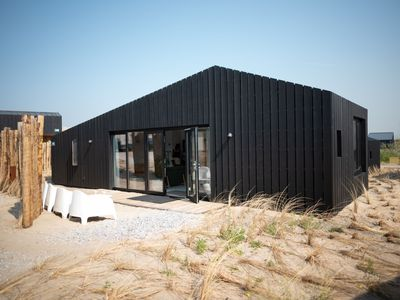 Photo for Modern lodge with two bathrooms, 100 m. from the beach