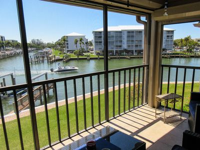 Photo for Great Fishing! Palm Trees And Sunshine! Lovely 1B/2B Estero Yacht & Racquet Club Condo On The Bay! Walk to Beach! Heated Pool!