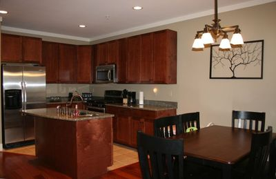 Kitchen with granite countertops and dining area