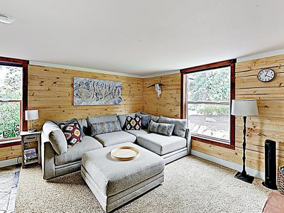 """Living Room - Unwind on the plush sectional around the 55"""" flat-screen TV."""