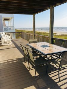 Main deck with stunning  views, dining area for 6 & 4 heavy duty rocking chairs