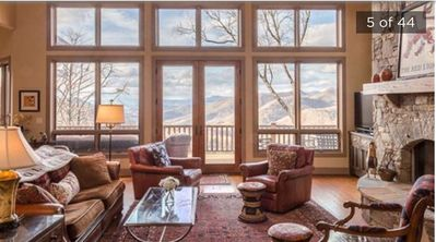 Living room: view looking toward Smoky Mountains, fireplace, 2 sofas, 3 chairs