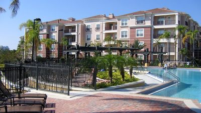 View of back side of building,  next to the pool. Condo located at upper left