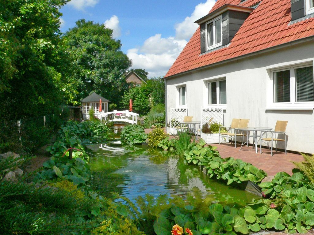 Apartments in the garden located at the koi pond and for Virtual koi fish pond