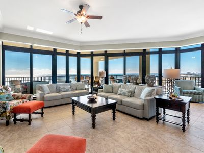 Family room with ample seating open to large balcony and incredible beach view
