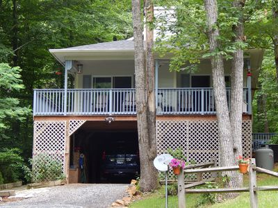 Front of house in summer showing covered parking.