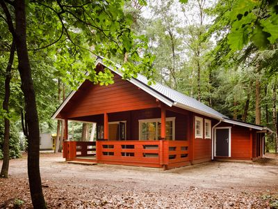Photo for Attractive, wooden lodge in holiday resort with pool, set in the heart of the Veluwe region