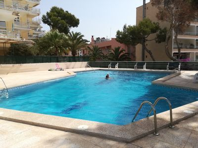 Photo for FIRSTLINE SEAVIEW FLAT WITH POOL IN PAGUERA