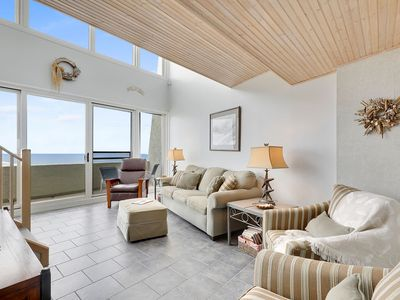 Photo for Lovely two-level oceanfront condo with three bedrooms, free WiFi, direct ocean view, and an outdoor pool located midtown and just steps to the beach!