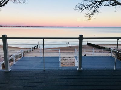 sun setting yields a pink sky.  Come relax on one of our decks.