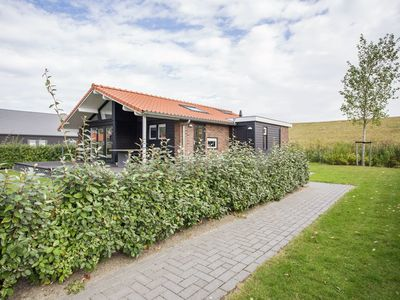 Photo for Luxurious holiday home on calm holiday park near Kattedijke in Zuid-Beveland