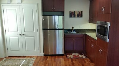 Kitchen features granite countertops and stainless appliances.