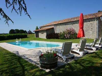 Photo for Spacious stone house with large private swimming pool in south facing garden